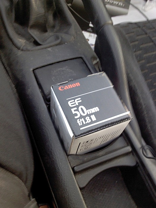Canon 50mm f/1.8 lens box in a car